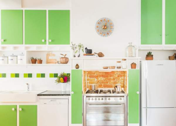 Can the green color dominate the interior of the kitchen?