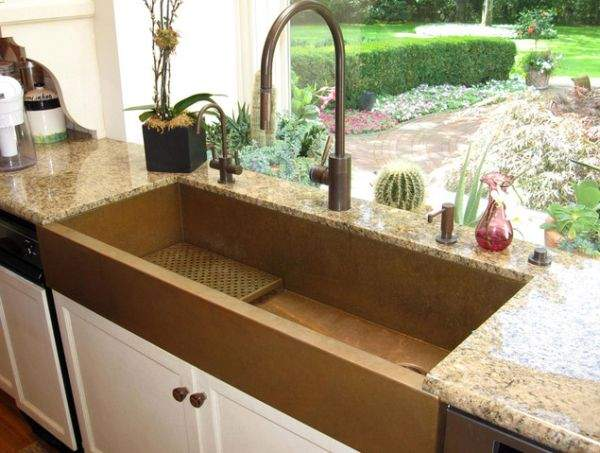 Table top, sink and other elements of copper in the design of your kitchen
