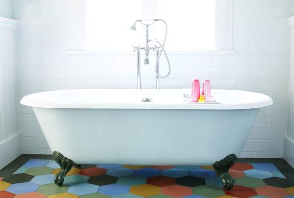 Vintage foot bath in the center of the classic bathroom interior