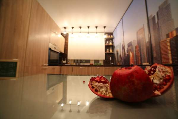 Wall-papers with a New York landscape in an interior of kitchen